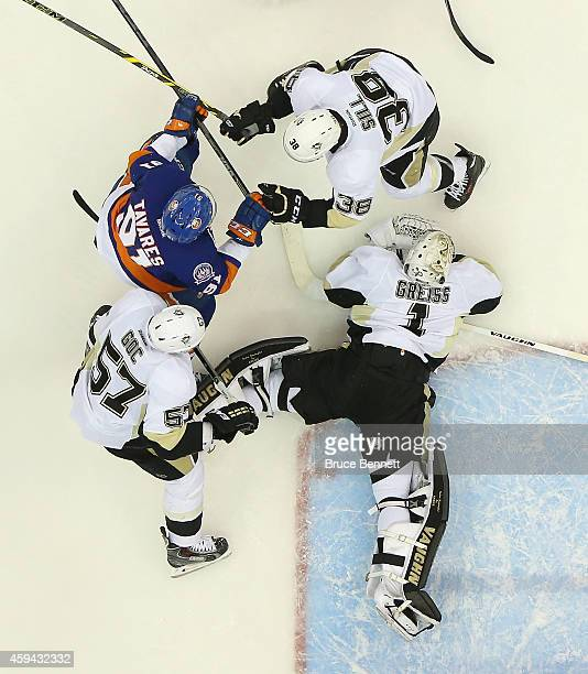 Marcel Goc Zach Sill and Thomas Greiss of the Pittsburgh Penguins defend against John Tavares of the New York Islanders at the Nassau Veterans...