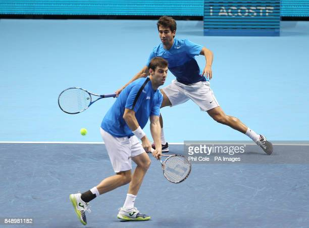 Marcel Granollers and Marc Lopez in action against AisamUlHaq Qureshi and JeanJulien Rojer during the Barclays ATP World Tour Finals at the O2 Arena...