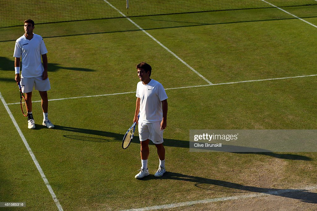 Marcel Granollers (l) and <a gi-track='captionPersonalityLinkClicked' href=/galleries/search?phrase=Marc+Lopez&family=editorial&specificpeople=2564593 ng-click='$event.stopPropagation()'>Marc Lopez</a> of Spain during their Gentlemen's Doubles third round match against Nicolas Mahut and Michael Lodra of France on day eight of the Wimbledon Lawn Tennis Championships at the All England Lawn Tennis and Croquet Club on July 1, 2014 in London, England.