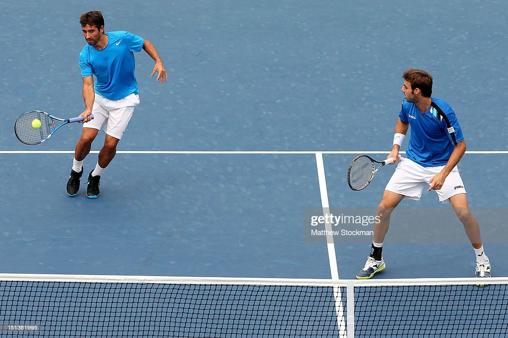 Marcel Granollers and <a gi-track='captionPersonalityLinkClicked' href=/galleries/search?phrase=Marc+Lopez&family=editorial&specificpeople=2564593 ng-click='$event.stopPropagation()'>Marc Lopez</a> of Spain play against Leander Paes of India and Radek Stepanek of the Czech Republic during Day Eleven of the 2012 US Open at USTA Billie Jean King National Tennis Center on September 6, 2012 in the Flushing neighborhood of the Queens borough of New York City.