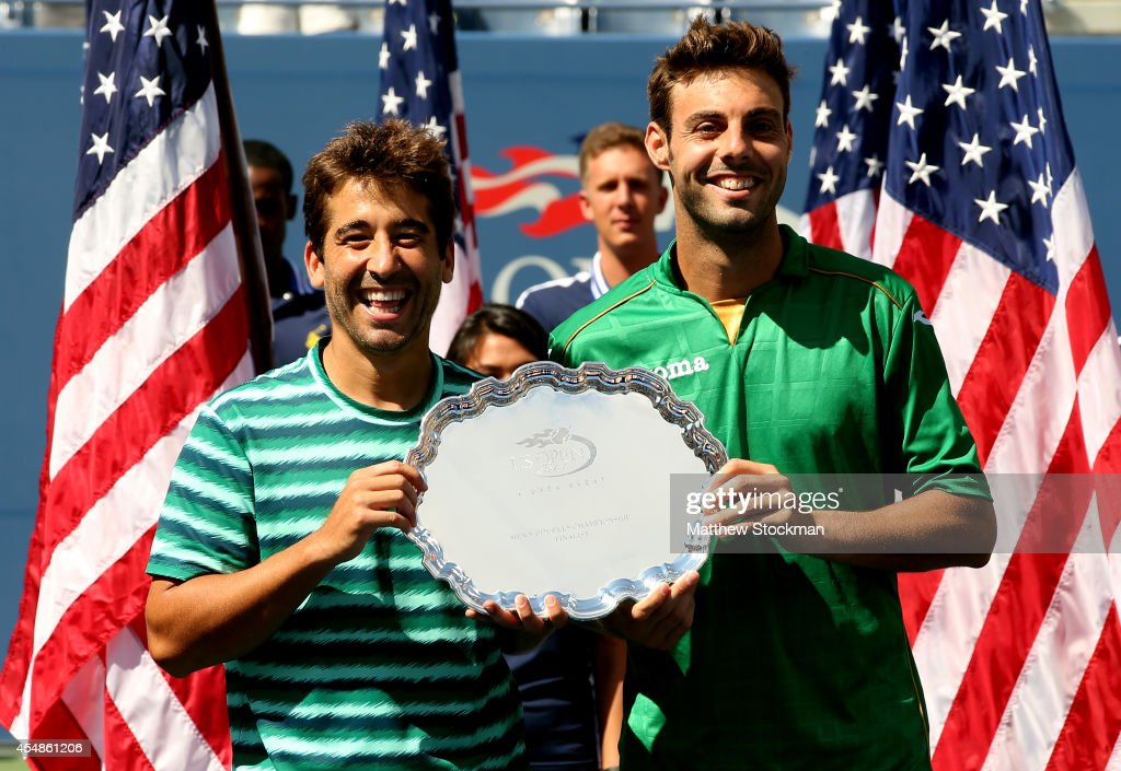Marcel Granollers (R) and Marc Lopez (L) of Spain pose with the second place trophy after being defeated by Bob Bryan and Mike Bryan of United States in their men's doubles final match on Day fourteen of the 2014 US Open at the USTA Billie Jean King National Tennis Center on September 7, 2014 in the Flushing neighborhood of the Queens borough of New York City.