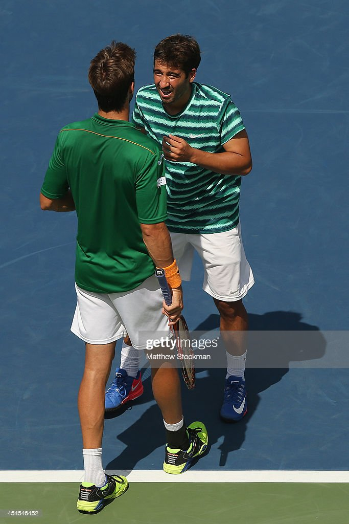 Marcel Granollers (R) and <a gi-track='captionPersonalityLinkClicked' href=/galleries/search?phrase=Marc+Lopez&family=editorial&specificpeople=2564593 ng-click='$event.stopPropagation()'>Marc Lopez</a> (L) of Spain react against Alexander Peya of Austria and Bruno Soares of Brazil during their men's doubles quarterfinal match on Day Ten of the 2014 US Open at the USTA Billie Jean King National Tennis Center on September 3, 2014 in the Flushing neighborhood of the Queens borough of New York City.