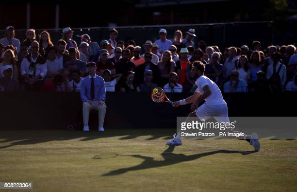 Marcel Granollers in action against Dudi Sela on day two of the Wimbledon Championships at The All England Lawn Tennis and Croquet Club Wimbledon