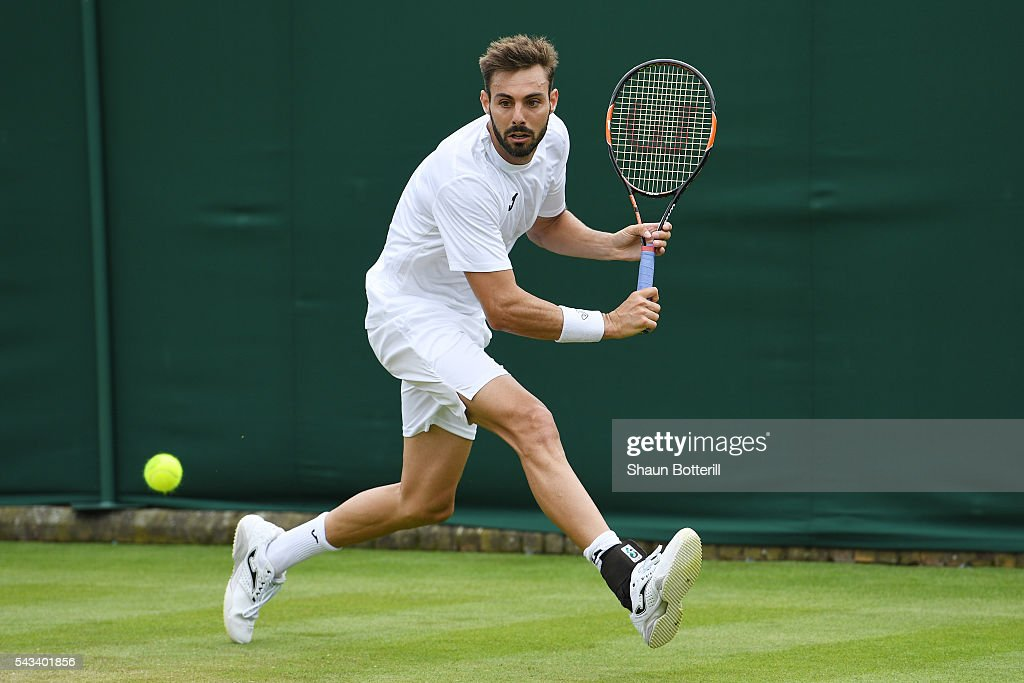Marcel Granollers of Dominican Republic plays a backhand during the Men's Singles first round match against Marcel Granollers of Spain on day two of...