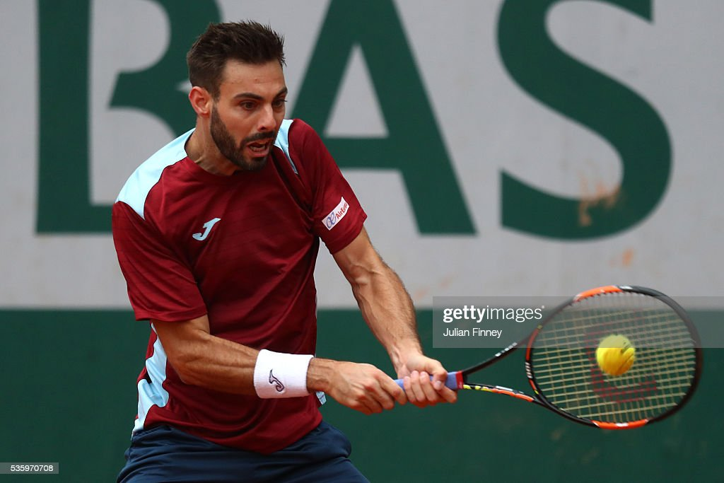 <a gi-track='captionPersonalityLinkClicked' href=/galleries/search?phrase=Marcel+Granollers&family=editorial&specificpeople=14432149 ng-click='$event.stopPropagation()'>Marcel Granollers</a> of France hits a backhand during the Men's Singles fourth round match against Dominic Thiem of Austria on day ten of the 2016 French Open at Roland Garros on May 31, 2016 in Paris, France.