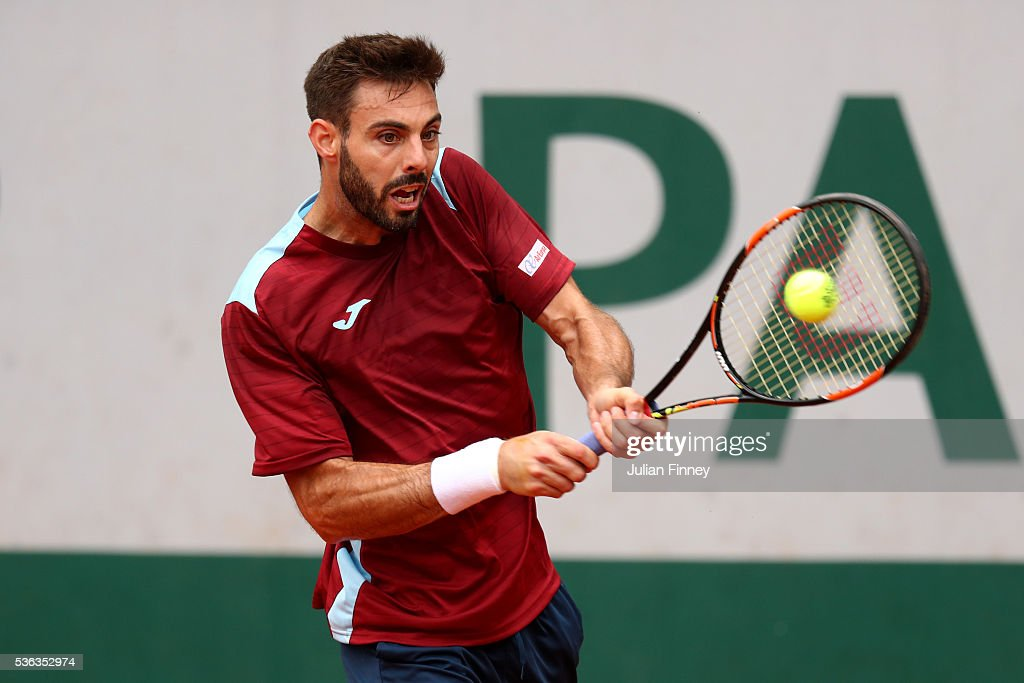 Marcel Granollers of France hits a backhand during the Men's Singles fourth round match against Dominic Thiem of Austria on day eleven of the 2016...