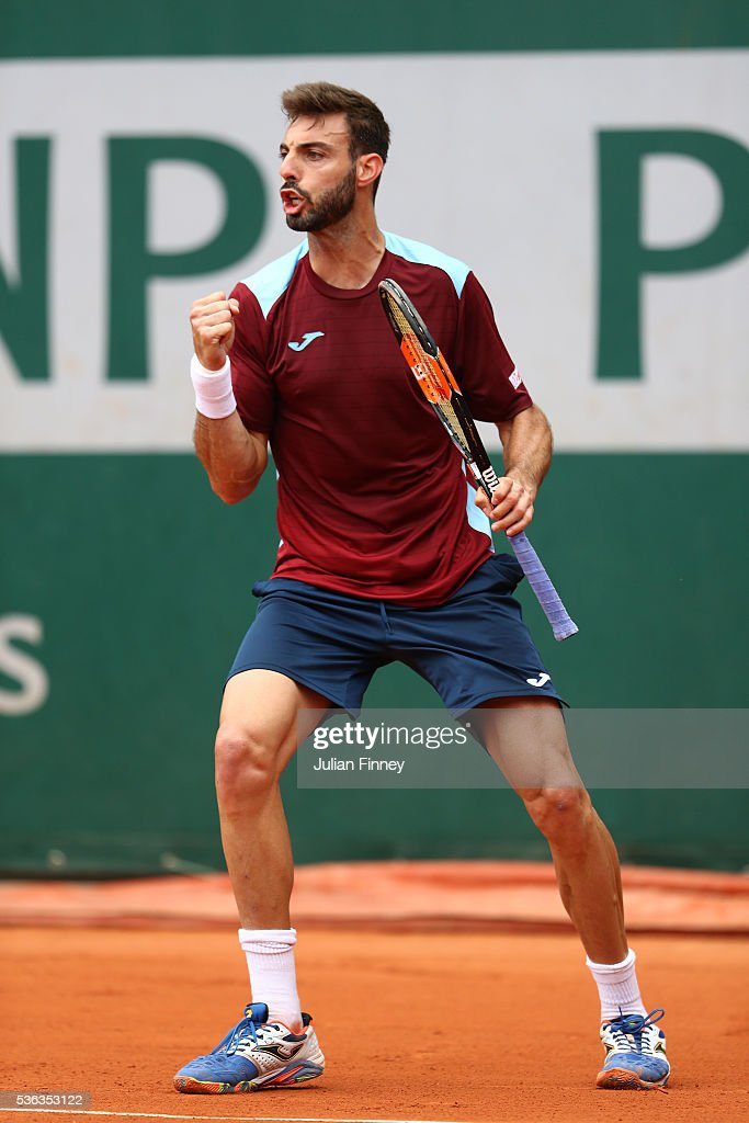 Marcel Granollers of France reacts during the Men's Singles fourth round match against Dominic Thiem of Austria on day eleven of the 2016 French Open...