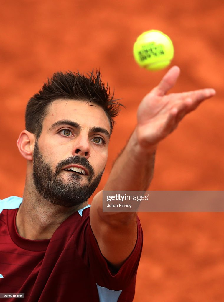 Marcel Granollers of France serves during the Men's Singles fourth round match against Dominic Thiem of Austria on day ten of the 2016 French Open at...
