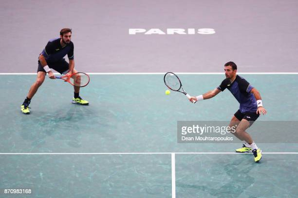 Marcel Granollers of Spain and Ivan Dodig of Croatia compete in the Mens Doubles Final against Marcelo Melo of Brazil and Lukasz Kubot of Poland...