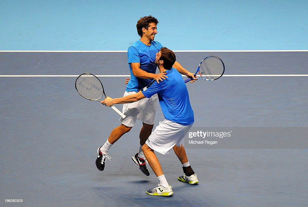 Marcel Granollers of Spain and <a gi-track='captionPersonalityLinkClicked' href=/galleries/search?phrase=Marc+Lopez&family=editorial&specificpeople=2564593 ng-click='$event.stopPropagation()'>Marc Lopez</a> of Spain celebrate victory after their men's doubles final match against Rohan Bopanna of India and Mahesh Bhupathi of India during day eight of the ATP World Tour Finals at O2 Arena on November 12, 2012 in London, England.