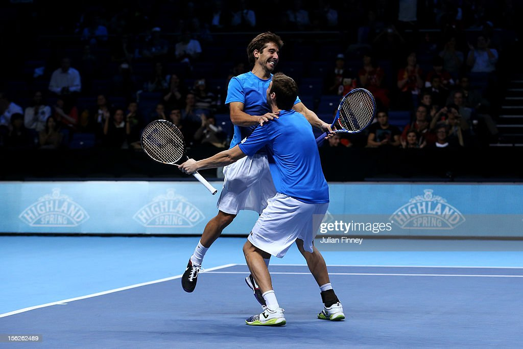 Marcel Granollers of Spain and Marc Lopez of Spain celebrate victory after their men's doubles final match against Rohan Bopanna of India and Mahesh Bhupathi of India during day eight of the ATP World Tour Finals at O2 Arena on November 12, 2012 in London, England.