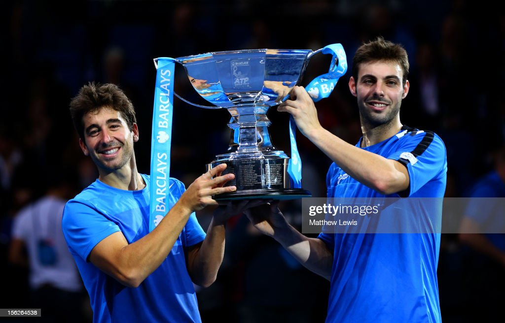 Marcel Granollers of Spain and <a gi-track='captionPersonalityLinkClicked' href=/galleries/search?phrase=Marc+Lopez&family=editorial&specificpeople=2564593 ng-click='$event.stopPropagation()'>Marc Lopez</a> of Spain pose with the trophy after their men's doubles final match against Rohan Bopanna of India and Mahesh Bhupathi of India during day eight of the ATP World Tour Finals at O2 Arena on November 12, 2012 in London, England.