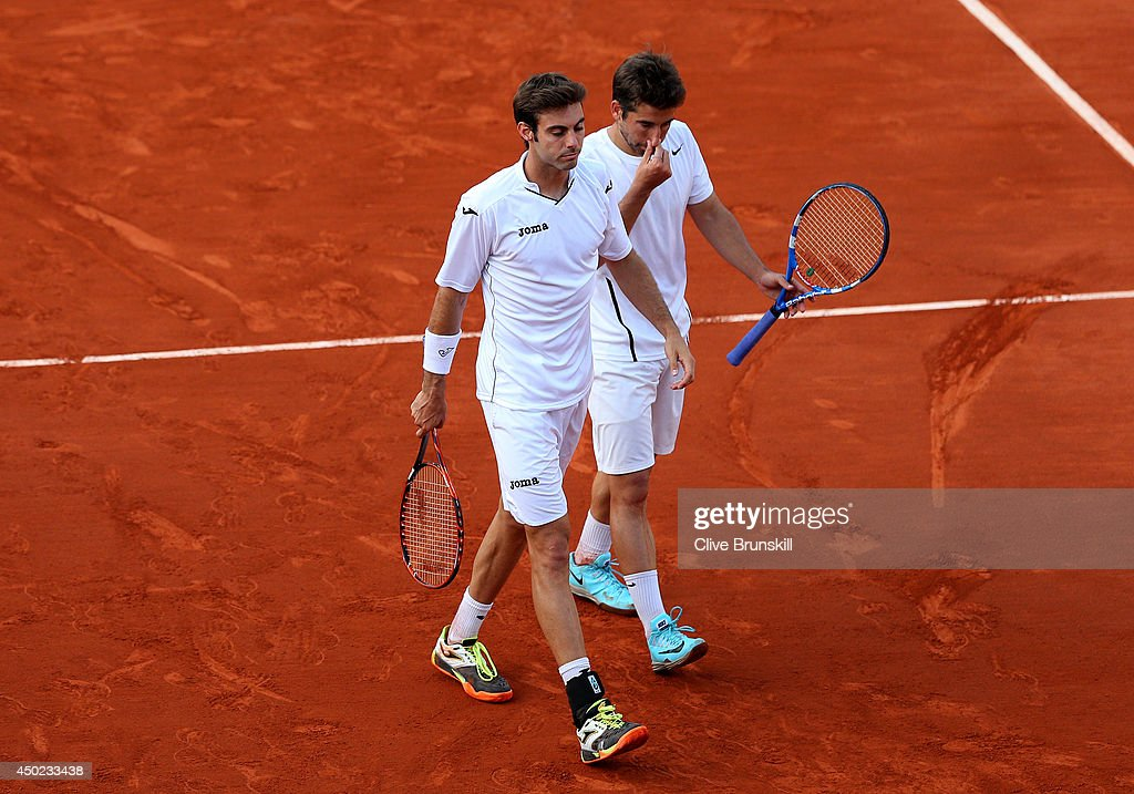 Marcel Granollers of Spain and <a gi-track='captionPersonalityLinkClicked' href=/galleries/search?phrase=Marc+Lopez&family=editorial&specificpeople=2564593 ng-click='$event.stopPropagation()'>Marc Lopez</a> of spain react during their men's doubles final match against Julien Benneteau of France and Edouard Roger-Vasselin of France on day fourteen of the French Open at Roland Garros on June 7, 2014 in Paris, France.