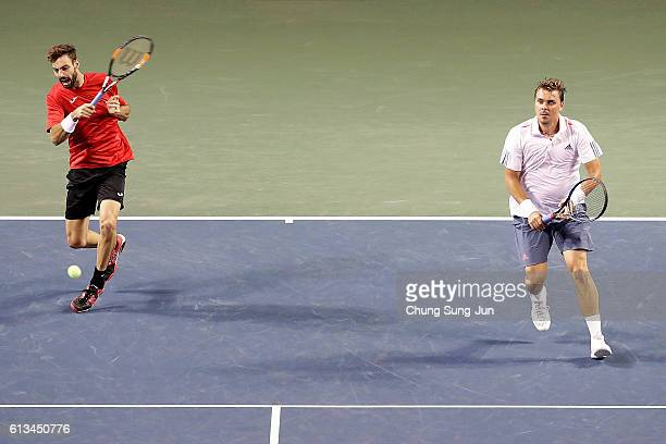 Marcel Granollers of Spain and Marcin Matkowski of Poland in action during the men's doubles final match against Raven Klaasen of South Africa and...