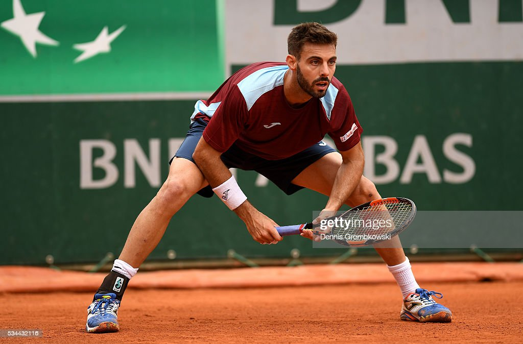 Marcel Granollers of Spain awaits a serve during the Men's Singles second round match against Nicolas Mahut of France on day five of the 2016 French Open at Roland Garros on May 26, 2016 in Paris, France.