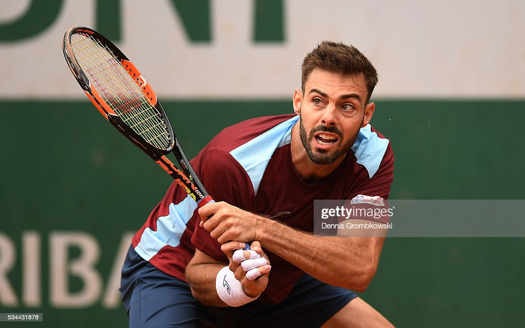 <a gi-track='captionPersonalityLinkClicked' href=/galleries/search?phrase=Marcel+Granollers&family=editorial&specificpeople=14432149 ng-click='$event.stopPropagation()'>Marcel Granollers</a> of Spain hits a backhand during the Men's Singles second round match against Nicolas Mahut of France on day five of the 2016 French Open at Roland Garros on May 26, 2016 in Paris, France.