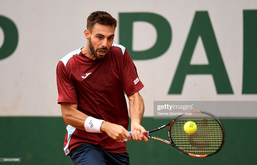 Marcel Granollers of Spain hits a backhand during the Men's Singles second round match against Nicolas Mahut of France on day five of the 2016 French...