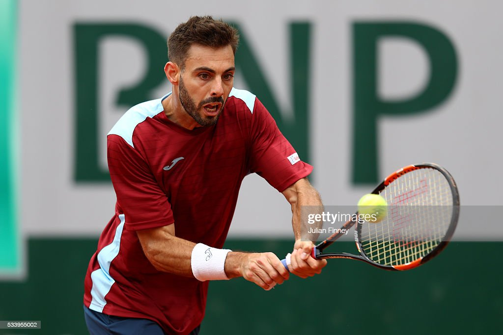 Marcel Granollers of Spain plays a backhand during the Men's Singles first round match against Fabio Fognini of Italy on day three of the 2016 French...