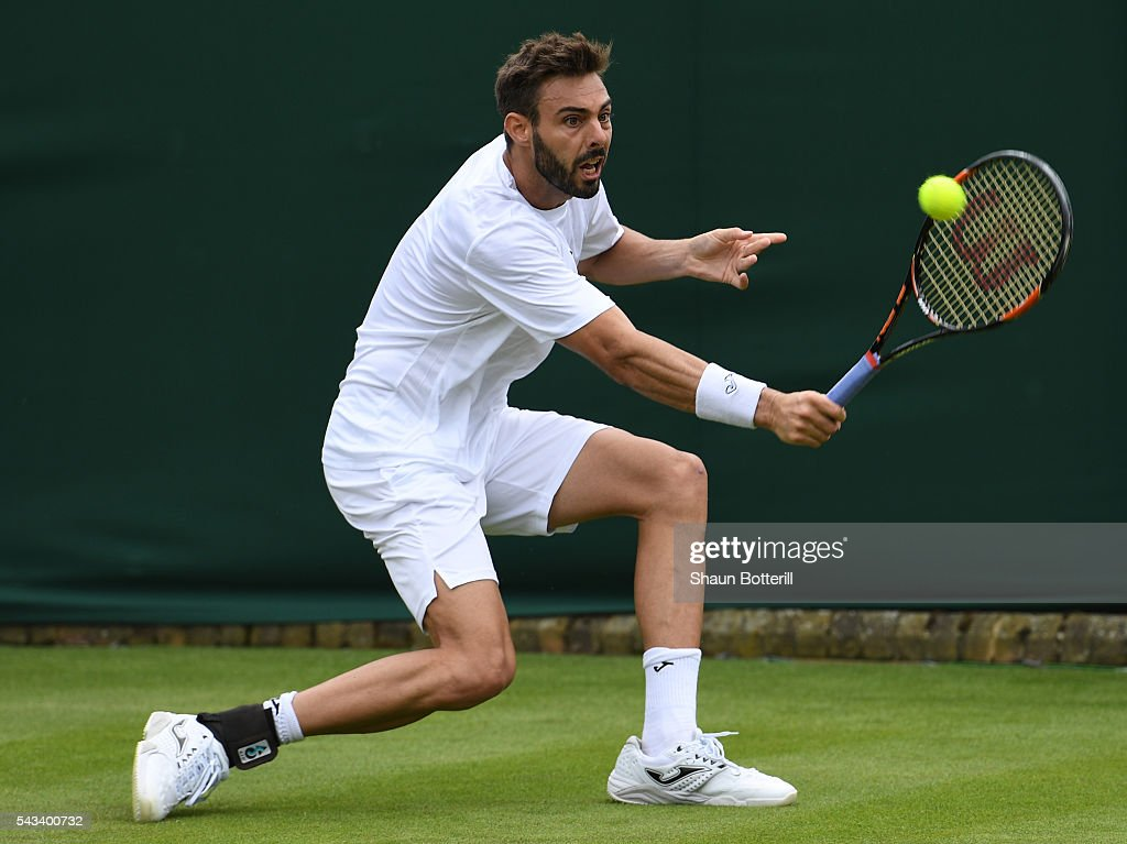 Marcel Granollers of Spain plays a backhand during the Men's Singles first round match against Victor Estrella Burgos of Dominican Republic on day...