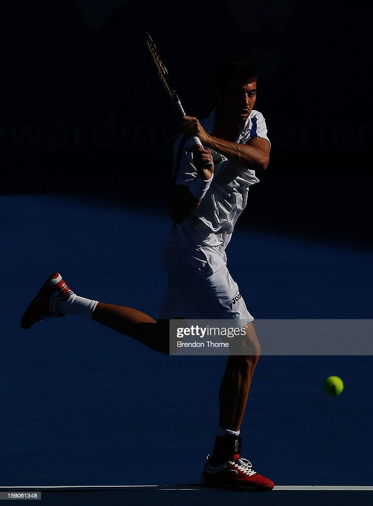 Marcel Granollers of Spain plays a backhand in his first round match against Matthew Ebden of Australia during day two of the Sydney International at Sydney Olympic Park Tennis Centre on January 7, 2013 in Sydney, Australia.