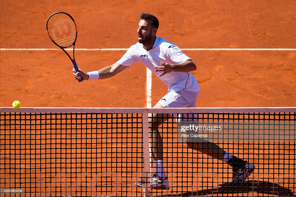 Marcel Granollers of Spain plays a forehand during his final doubles match with Pablo Cuevas of Uruguay against Bob Bryan and Mike Bryan of the...