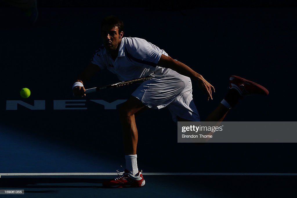 Marcel Granollers of Spain plays a forehand in his first round match against Matthew Ebden of Australia during day two of the Sydney International at Sydney Olympic Park Tennis Centre on January 7, 2013 in Sydney, Australia.