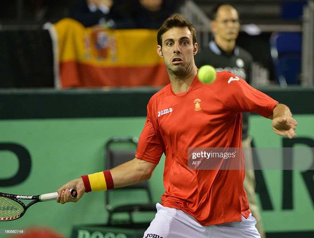 Marcel Granollers of Spain plays against Daniel Nestor and Vasek Pospisil of Canada during a Davis Cup World Group Doubles Rubber, February 2, 2013, at the Doug Mitchell Thunderbird Sports Centre, in Vancouver, BC. AFP PHOTO / Don MACKINNON