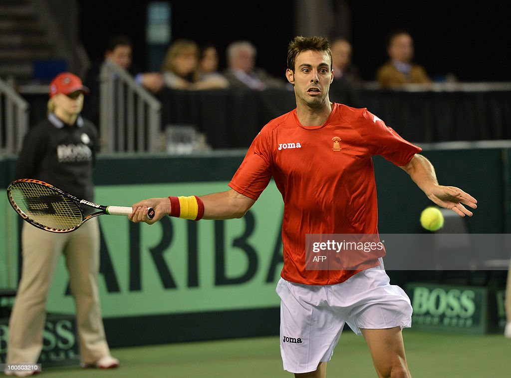 Marcel Granollers of Spain plays against Frank Dancevic of Canada during a Davis Cup World Group 2nd Singles Rubber, at the Doug Mitchell Thunderbird Sports Centre, in Vancouver BC, on February 1, 2013. AFP PHOTO/Don MacKinnon