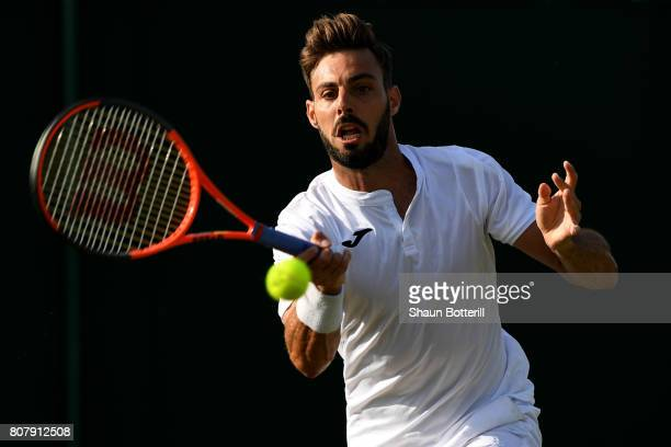 Marcel Granollers of Spain plays plays a forehand during the Gentlemen's Singles first round match against Dudi Sela on day two of the Wimbledon Lawn...