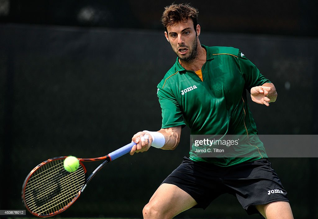 Marcel Granollers of Spain returns a shot from Yen-Hsun Lu of Chinese Taipei during the Winston-Salem Open at Wake Forest University on August 20, 2014 in Winston Salem, North Carolina.