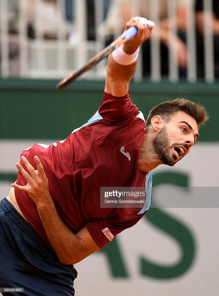 Marcel Granollers of Spain serves during the Men's Singles second round match against Nicolas Mahut of France on day five of the 2016 French Open at...