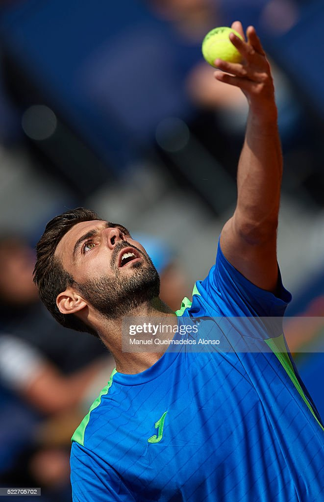 Marcel Granollers of Spain serves to Rafael Nadal of Spain during day three of the Barcelona Open Banc Sabadell at the Real Club de Tenis Barcelona...