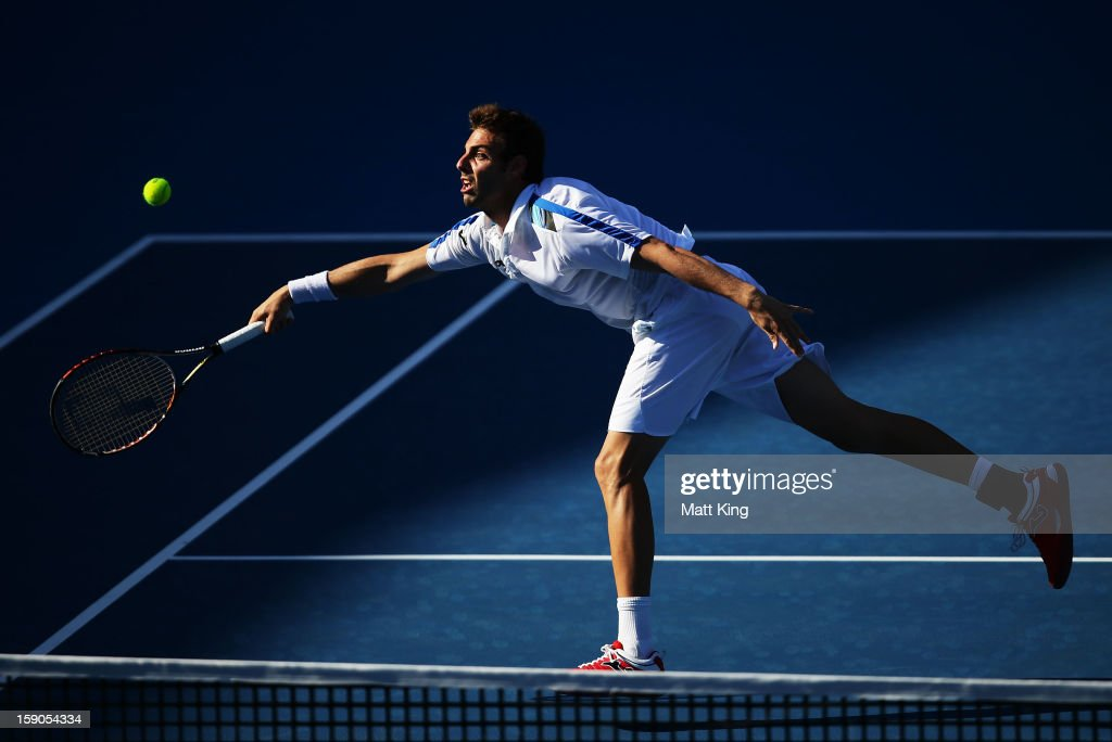 Marcel Granollers of Spain stretches out for a forehand volley in his first round match against Matthew Ebden of Australia during day two of the Sydney International at Sydney Olympic Park Tennis Centre on January 7, 2013 in Sydney, Australia.