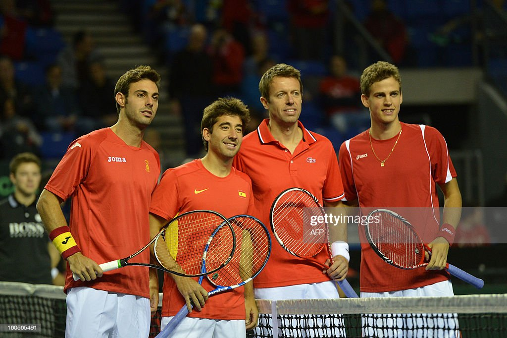 Marcel Granollers with teammate Marc Lopez of Spain and Daniel Nestor with teammate Vasek Pospisil of Canada pose for a group picture before their Davis Cup World Group Doubles Rubber, February 2, 2013, at the Doug Mitchell Thunderbird Sports Centre, in Vancouver, BC. AFP PHOTO / Don MACKINNON