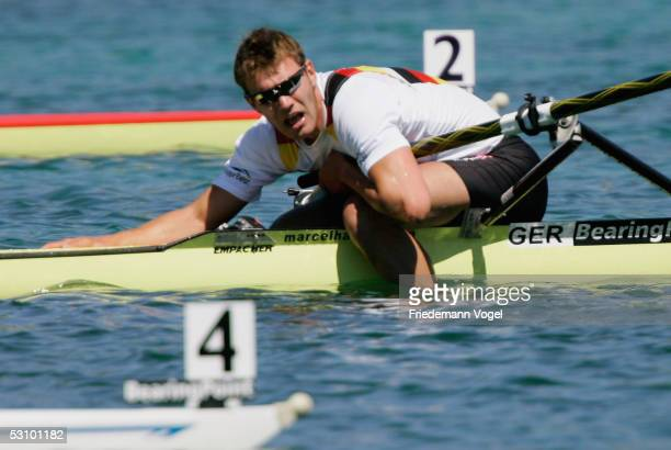 Marcel Hacker of Germany has a muscle cramp after the winning Men's single sculls of the BearingPoint Rowing World Cup 2005 on June 19 2005 in Munich...