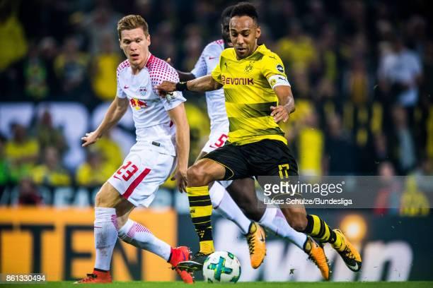 Marcel Halstenberg of Leipzig and PierreEmerick Aubameyang of Dortmund fight for the ball during the Bundesliga match between Borussia Dortmund and...