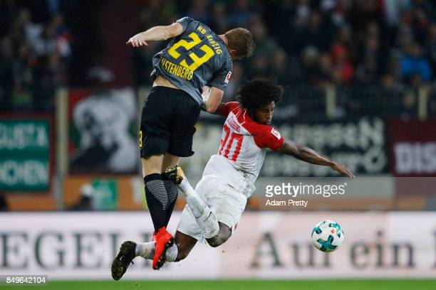 Marcel Halstenberg of Leipzig fights for the ball with Caiuby of Augsburg during the Bundesliga match between FC Augsburg and RB Leipzig at WWKArena...
