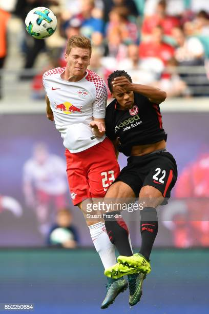 Marcel Halstenberg of Leipzig fights for the ball with Timothy Chandler of Frankfurt during the Bundesliga match between RB Leipzig and Eintracht...