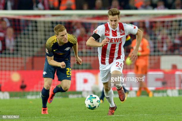 Marcel Halstenberg of Leipzig Lukas Kluenter of Koeln battle for the ball during the Bundesliga match between 1 FC Koeln and RB Leipzig at...