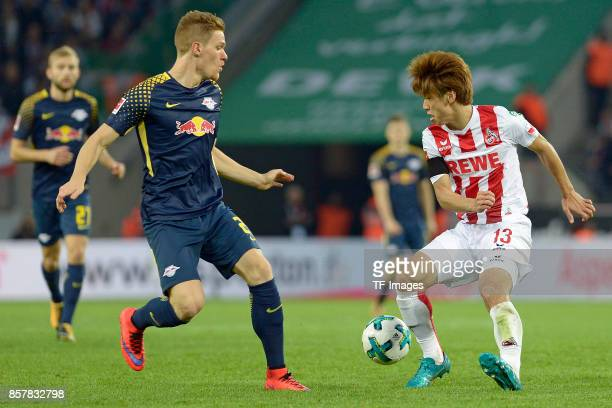Marcel Halstenberg of Leipzig Yuya Osako of Koeln battle for the ball during the Bundesliga match between 1 FC Koeln and RB Leipzig at...