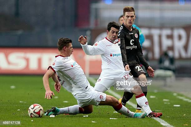 Marcel Halstenberg of Pauli and Amin Younes of Kaiserslautern compete for the ball during the Second Bundesliga match between FC St Pauli and 1 FC...