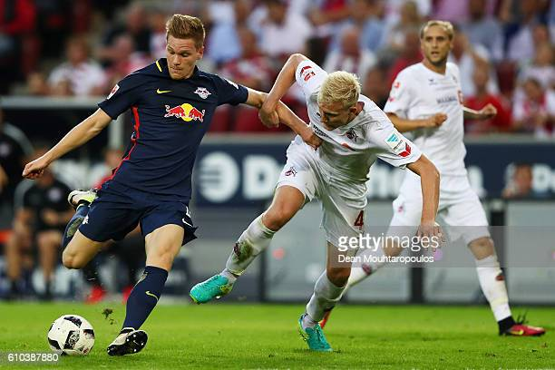 Marcel Halstenberg of RB Leipzig battles for the ball with Frederik Sorensen of Koeln during the Bundesliga match between 1 FC Koeln and RB Leipzig...