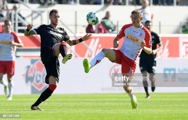 Marcel Hartel of 1 FC Union Berlin and Marc Lais of SSV Jahn Regensburg during the Second Bundesliga match between Jahn Regensburg and Union Berlin...
