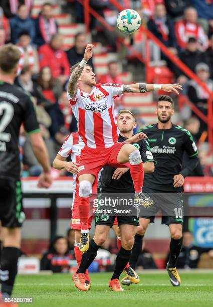 Marcel Hartel of 1 FC Union Berlin Levent Aycicek and Jurgen Gjasula of the SpVgg Greuther Fuerth during the game between Union Berlin and the SpVgg...