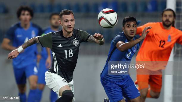 Marcel Hartel of Germany is challenged by Gismat Aliyev of Azerbaijan during the UEFA Under21 Euro 2019 Qualifier match between Azerbaijan U21 and...