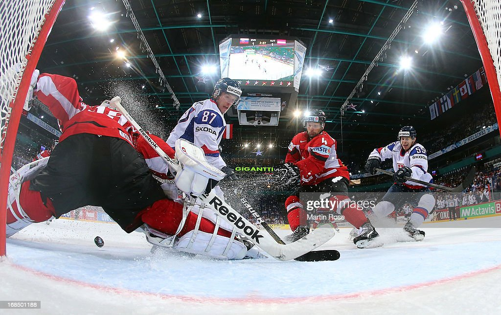 Marcel Hascak (#87) of Slovakia fails to score over Bernhard Starkbaum (L), goaltender of Austria during the IIHF World Championship group H match between Slovakia and Austria at Hartwall Areena on May 10, 2013 in Helsinki, Finland.