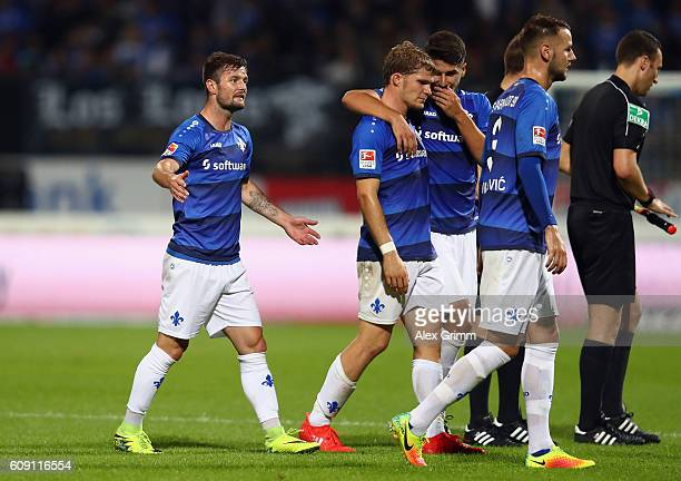 Marcel Heller and team mates of Darmstadt react at halftime of the Bundesliga match between SV Darmstadt 98 and TSG 1899 Hoffenheim at...