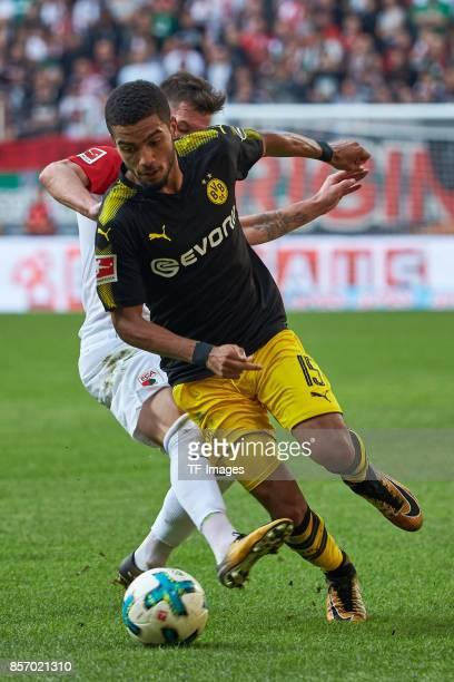 Marcel Heller of Augsburg and Jeremy Toljan of Dortmund battle for the ball during the Bundesliga match between FC Augsburg and Borussia Dortmund at...