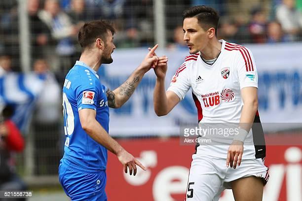 Marcel Heller of Darmstadt and Benjamin Huebner of Ingolstadt argue during the Bundesliga match between SV Darmstadt 98 and FC Ingolstadt at...