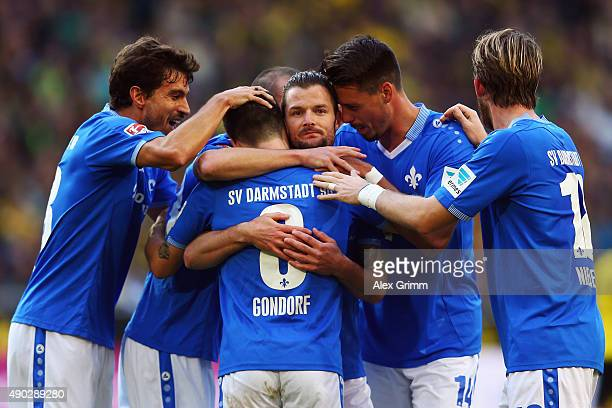 Marcel Heller of Darmstadt celebrates his team's first goal with team mates during the Bundesliga match between Borussia Dortmund and SV Darmstadt 98...